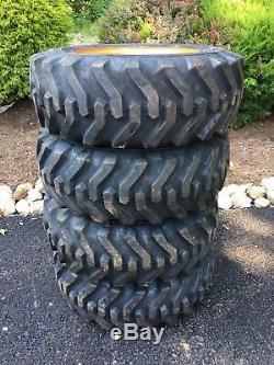 4 NEW 10-16.5 Skid Steer Tires/wheels/rims for Kubota SSV65 Camso sks332